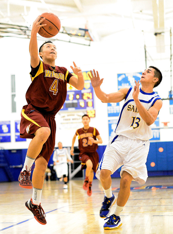 . Wilson\'s Justin Chan (4) goes for a layup as San Dimas\' Tony Hugo (13) tries to block as Wilson defeats San Dimas 45-43 Friday night, January 10, 2014 at San Dimas High School.  (Photo by Sarah Reingewirtz/Pasadena Star-News)
