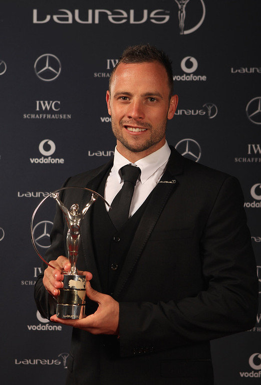 . Oscar Pistorius of South Africa the winner of the Laureus World Sportsperson of the Year with a Disability poses in the Winners Studio during the 2012 Laureus World Sports Awards at Central Hall Westminster on February 6, 2012 in London, England.  (Photo by Tom Shaw/Getty Images for Laureus) South African Paralympic athlete Oscar Pistorius has reportedly shot his girlfriend at his home in Pretoria. Police are questioning him over the incident with reports suggesting he mistook her for a burglar.