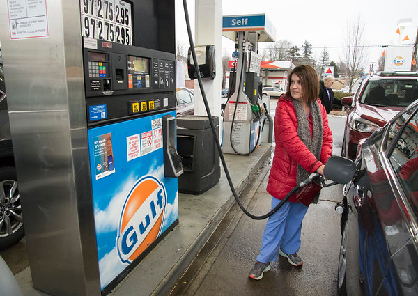 02/10/20 Wesley Bunnell | StaffrrCars lined up to take advantage of sub two dollar a gallon regular gas prices at the Gulf and CITGO Stations on Main St in the Terryville section of Plymouth. Yvonne Gerrick , a nurse at Bristol Hospital, stops at the Gulf Station.