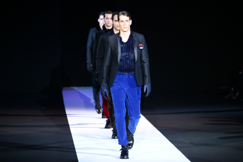 Description of . Models walk the runway during the Emporio Armani show as part of Milan Fashion Week Menswear Autumn/Winter 2013 on January 14, 2013 in Milan, Italy.  (Photo by Vittorio Zunino Celotto/Getty Images)