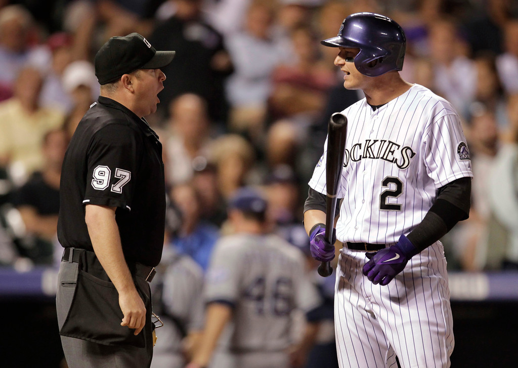. Colorado Rockies\' Troy Tulowitzki, right, argues a called third strike with home plate umpire Todd Tichenor after Tulowitzki\'s strikeout ended the sixth inning of a baseball game against the San Diego Padres in Denver on Tuesday, Aug. 13, 2013. The Padres won 7-5. (AP Photo/Joe Mahoney)
