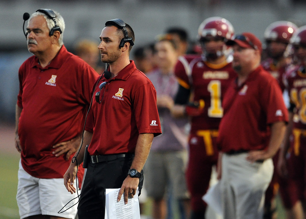 . Arcadia head coach Andrew Policky, second from left, in the first half of a prep football game against Monrovia at Arcadia High School in Arcadia, Calif. on Friday, Sept. 13, 2013.   (Photo by Keith Birmingham/Pasadena Star-News)