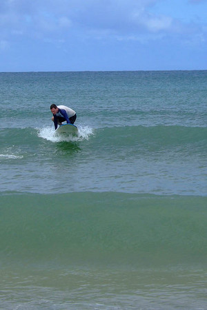 Surfing at Halalei Beach