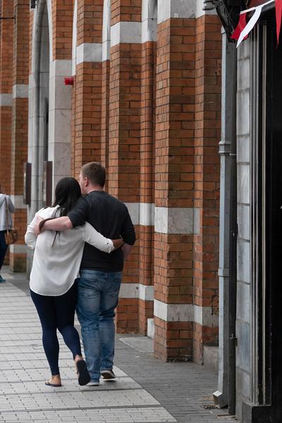 Couple embracing on the street, City of Cork, County Cork, Ireland