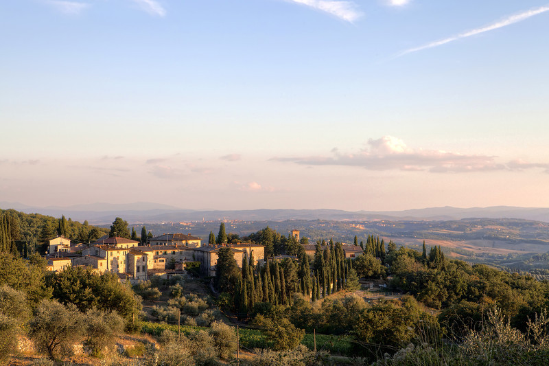 Tuscan-countryside-trees-vineyards-villa-town-sunset.jpg