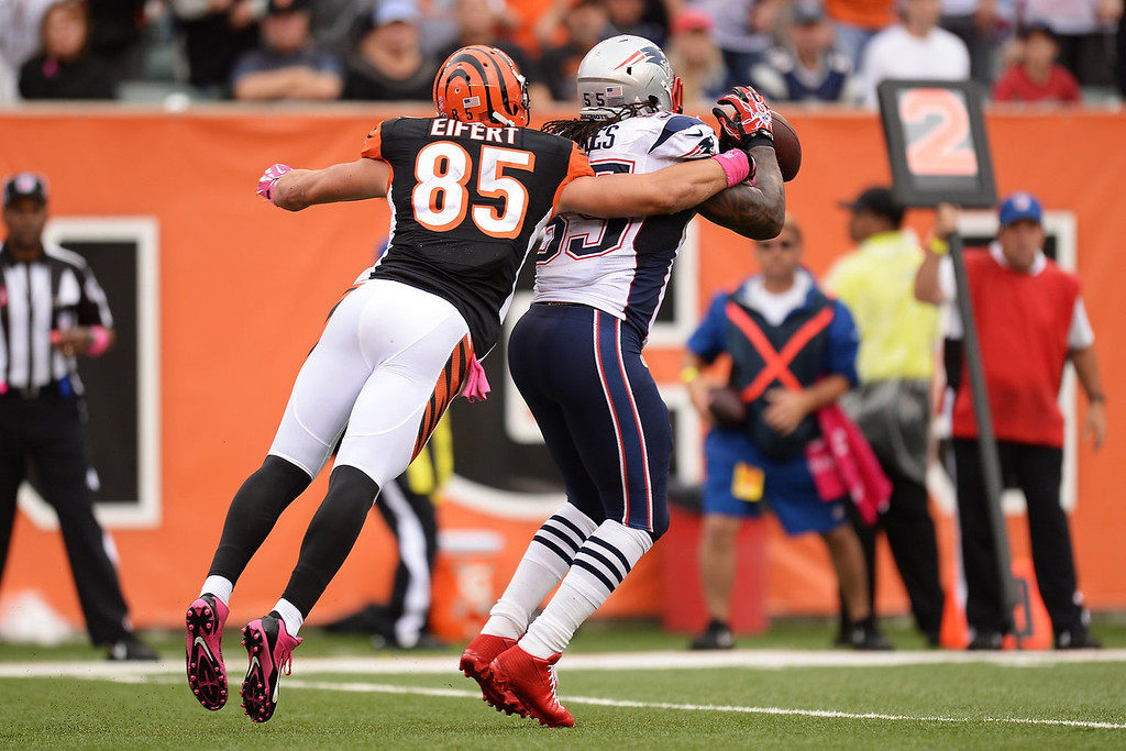 . Brandon Spikes #55 of the New England Patriots steps in front of Tyler Eifert #85 of the Cincinnati Bengals to intercept a pass in the first quarter at Paul Brown Stadium on October 6, 2013 in Cincinnati, Ohio.  (Photo by Jamie Sabau/Getty Images)
