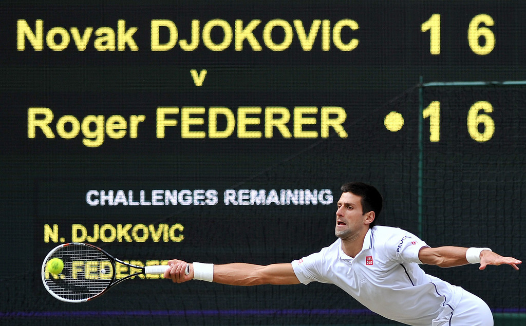 . Serbia\'s Novak Djokovic returns to Switzerland\'s Roger Federer during their men\'s singles final match on day thirteen of  the 2014 Wimbledon Championships at The All England Tennis Club in Wimbledon, southwest London, on July 6, 2014.   GLYN KIRK/AFP/Getty Images