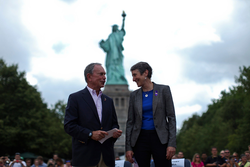 . Secretary of the Interior Sally Jewell (R) speaks with New York City Mayor Michael Bloomberg while they attend a ceremony to reopen the Statue of Liberty and Liberty Island to the public in New York July 4, 2013. Under steamy summer skies, tourists in New York flocked to ferries headed for the Statue of Liberty, re-opening with an Independence Day ceremony after closing in October as Superstorm Sandy approached.  REUTERS/Eduardo Munoz