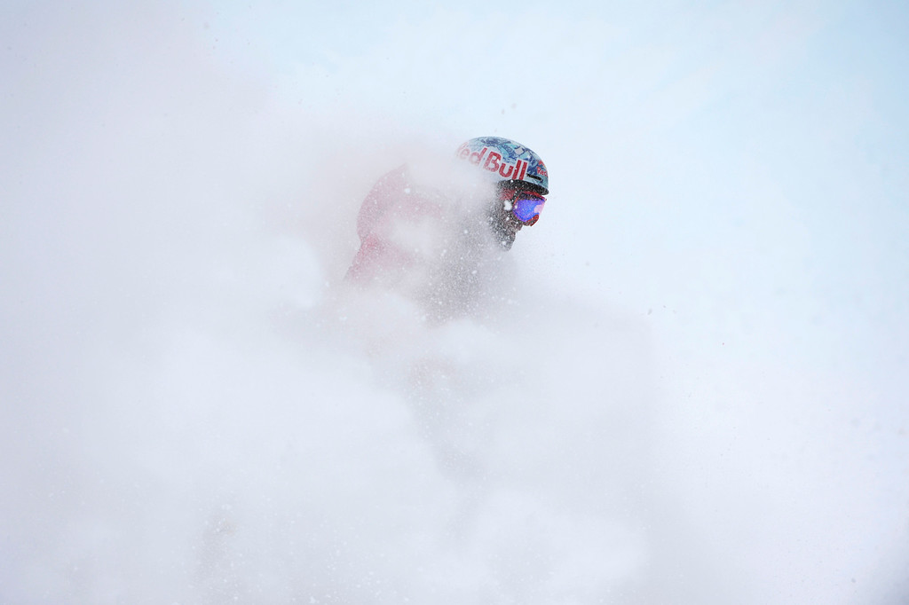 . Bobby Brown sprays snow at the finish area completing his second run at the U.S. Grand Prix slope style finals at the Copper Mountain ski area Saturday afternoon, December 21, 2013.  (Photo By Andy Cross / The Denver Post)