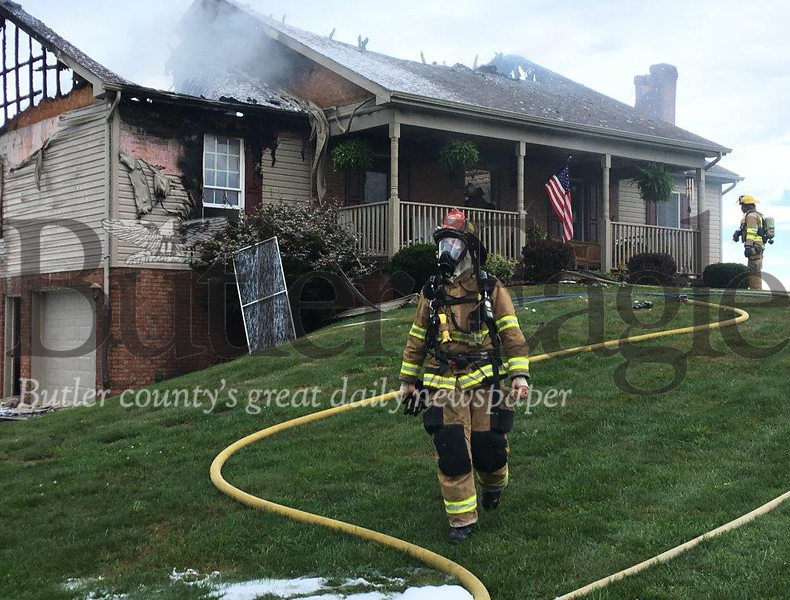 Lightning-caused fire Thursday badly damages house on Moore Road in Center Township.