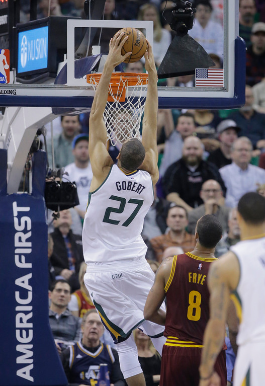 . Utah Jazz center Rudy Gobert (27) dunks the ball as Cleveland Cavaliers forward Channing Frye (8) looks on in the first half during an NBA basketball game Tuesday, Jan. 10, 2017, in Salt Lake City. (AP Photo/Rick Bowmer)