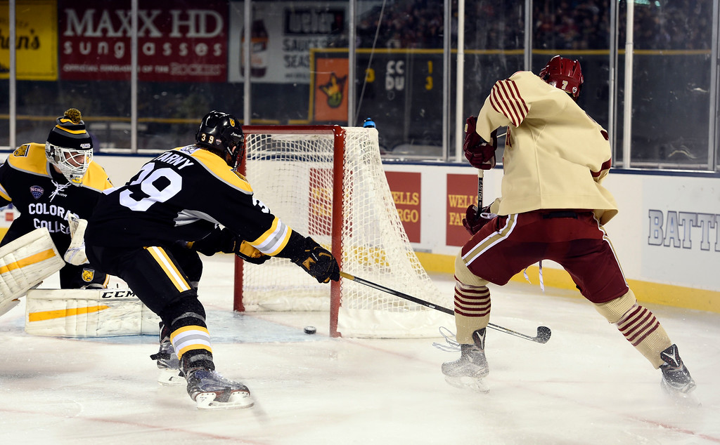 . Denver Pioneers forward Dylan Gambrell (7) scores a goal in the third period against Colorado College Tigers during the Battle On Blake February 20, 2016 at Coors Field. Denver Pioneers defeated Colorado College Tigers 4-1 in front of 35,144 hockey fans. (Photo By John Leyba/The Denver Post)