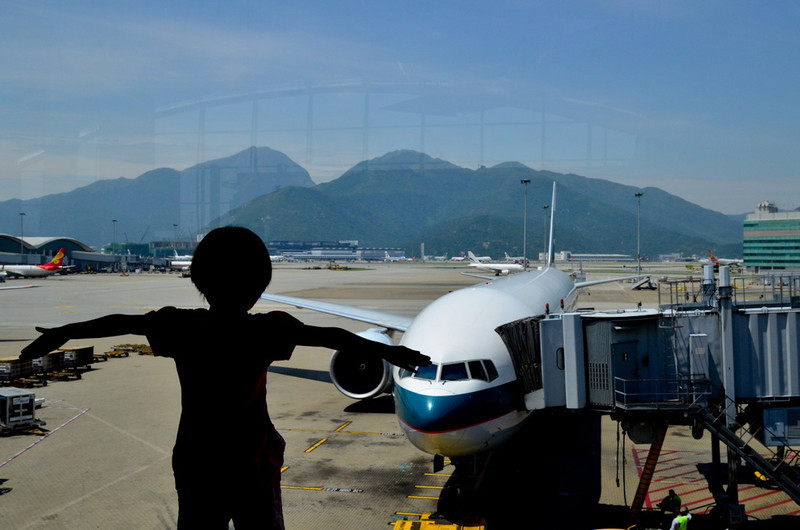 Tessa was fascinated with the airplanes - ready to take to the skies as she watched them.  This is in Hong Kong...little does she know she faces 14 hours cooped up in a plane!!