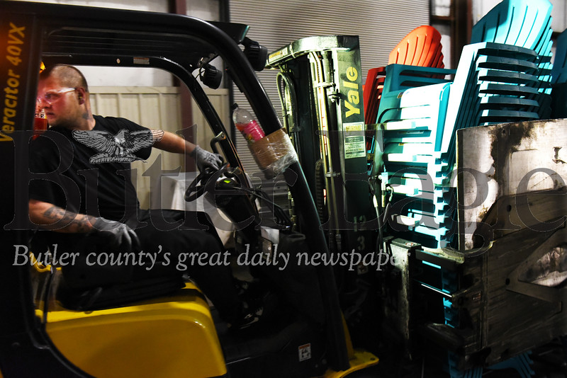 Harold Aughton/Butler Eagle: A forklift operator moves a pallet of Adirondack chairs to the loading dock at Adams Manufacturing in Portersville.