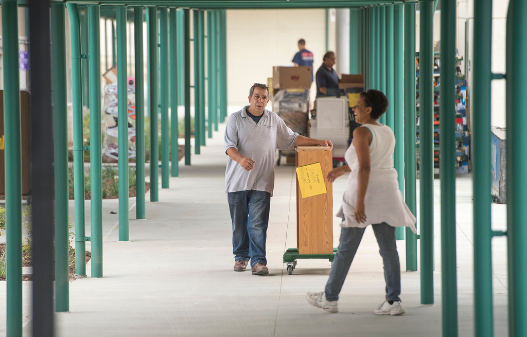. Workers move teachers\' belongings and classroom furniture to Rowland Elementary School\'s newly remodeled classrooms at the Rowland Heights campus August 7, 2013.   (SGVN/Staff photo by Leo Jarzomb)