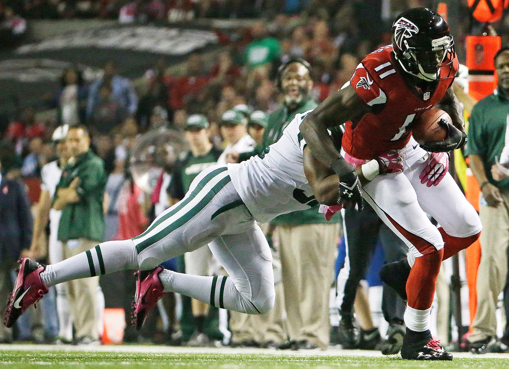 . Atlanta Falcons wide receiver Julio Jones (11) runs the ball after a catch against New York Jets defensive back Josh Bush (32) during the first half of an NFL football game, Monday, Oct. 7, 2013, in Atlanta. (AP Photo/David Goldman)