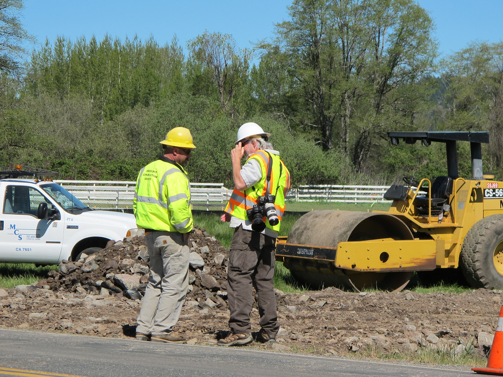 . CalTrans worker chats with TWN Photographer Steve Eberhard at the work site along Hearst Willits Road.