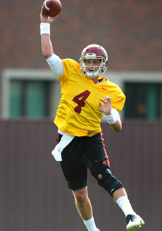 . USC QB Max Browne passes on a rollout during practice, Tuesday, March 25, 2014, at USC. (Photo by Michael Owen Baker/L.A. Daily News)
