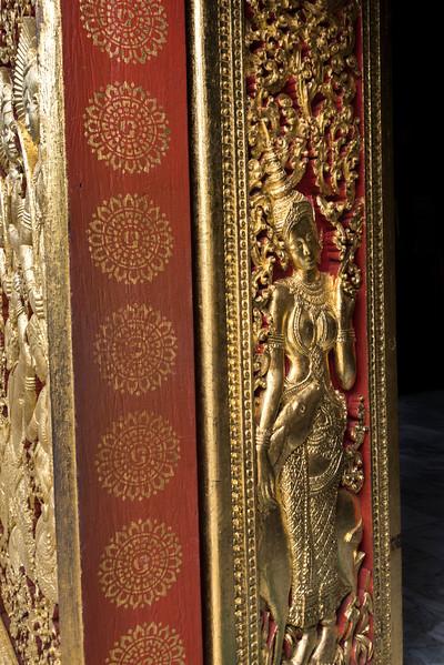 Sculpture carved on door of temple, Wat Xieng Thong temple, Luang Prabang, Laos