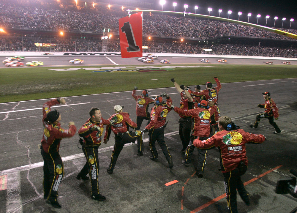. Crew members celebrate after driver Jamie McMurray won the NASCAR Daytona 500 auto race at Daytona International Speedway in Daytona Beach, Fla., Sunday, Feb. 14, 2010. (AP Photo/Reinhold Matay)
