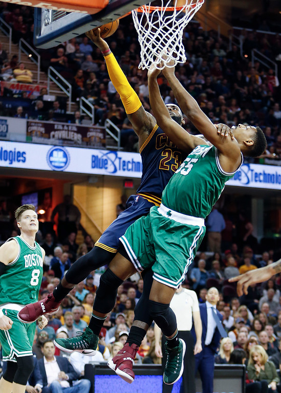 . Cleveland Cavaliers\' LeBron James (23) goes up to shoot against Boston Celtics\' Jordan Mickey (55) during the second half of an NBA basketball game Thursday, Nov. 3, 2016, in Cleveland.  (AP Photo/Ron Schwane)