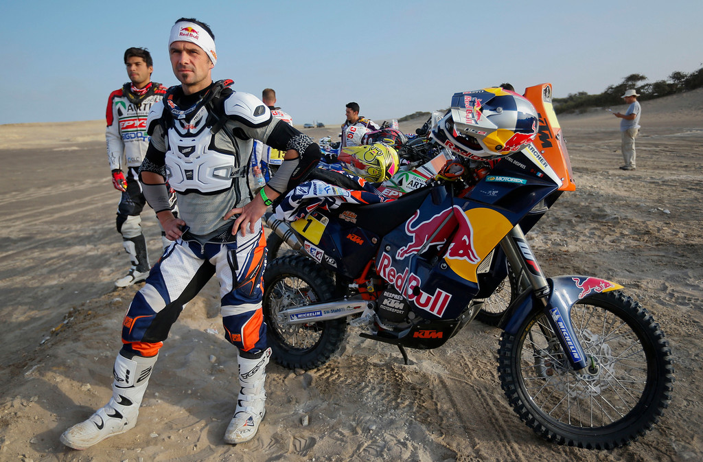 . KTM rider Cyril Despres, center, and KTM rider Andre Hirioyen, left, both of France, wait  for the start of the 3nd stage of the 2013 Dakar Rally from Pisco to Nazca, Peru, Monday, Jan. 7, 2013. The race finishes in Santiago, Chile, on Jan. 20. (AP Photo/Victor R. Caivano)