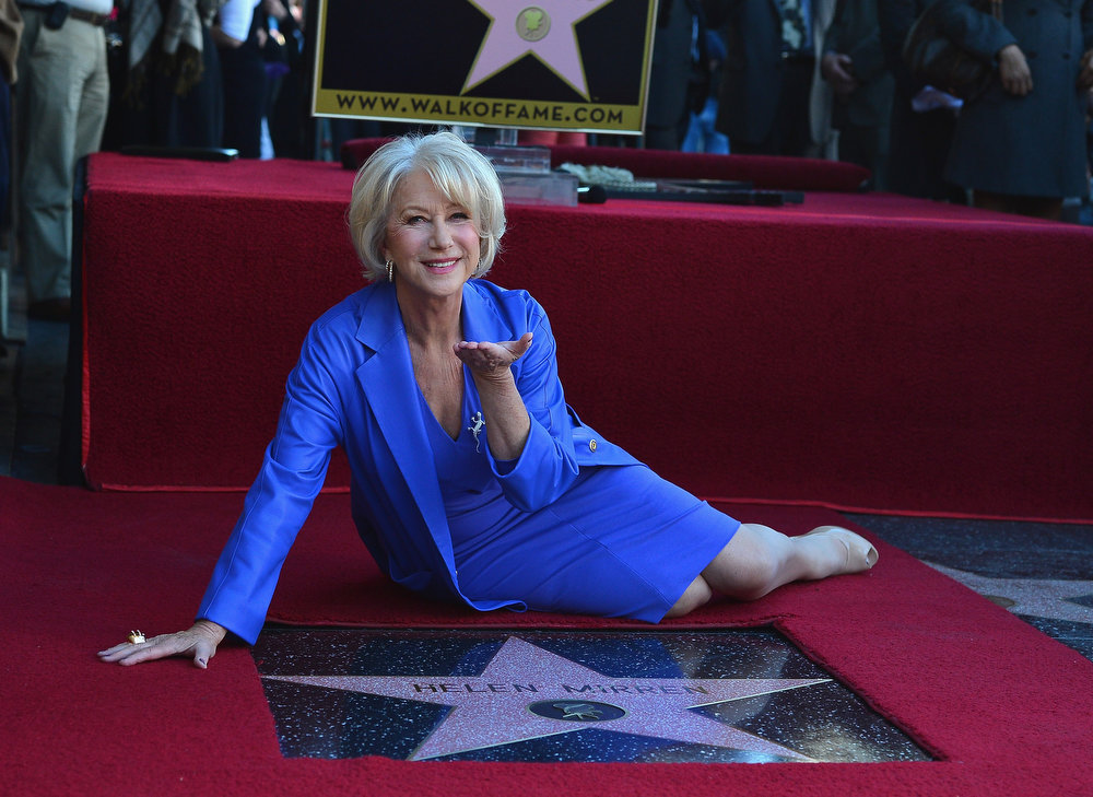Description of . Actress Helen Mirren honored on The Hollywood Walk Of Fame with a star on January 3, 2013 in Hollywood, California.  (Photo by Frazer Harrison/Getty Images)