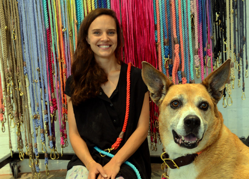 Tania Barricklo-Daily Freeman    Bethany Obrecht, founder of FOUND My Animal, accessories for adopted animals and their people poses with Claude who has enjoyed the move to their new location in Kingston, N.Y.