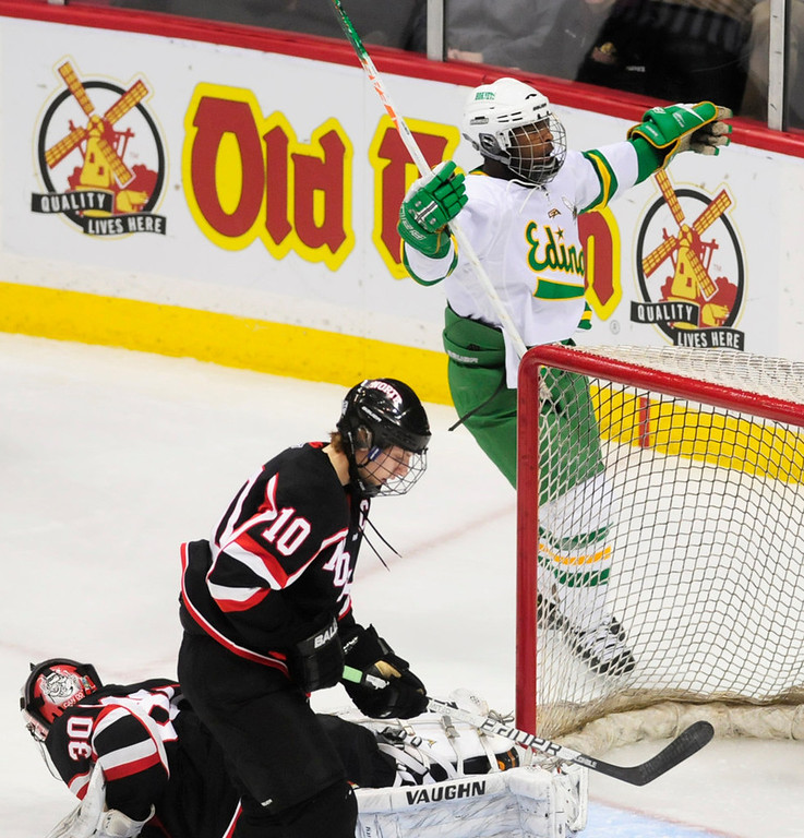 . Edina\'s Anthony Walsh celebrates his first-period goal against Lakeville North goalie Will DuPont, lower left. Following the play is Panthers defenseman Eric Rutt.  (Pioneer Press: Scott Takushi)