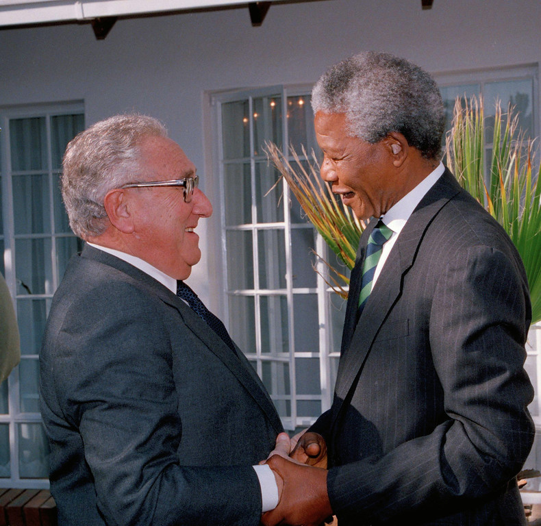 . Former U.S. Secretary of State Henry Kissinger, left, and African National Congress (ANC) president Nelson Mandela shake hands during their meeting in Johannesburg, South Africa, Wednesday, April 13, 1994.  Kissinger is in South Africa to try to end the bloody dispute between the ANC and the Zulu Inkatha Freedom Party, who are opposed to the upcoming all-race general elections.  (AP Photo/John Parkin)
