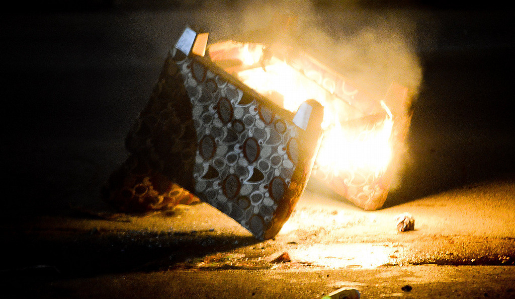 . A chair burns in a Dinkytown street. (Pioneer Press: Ben Garvin)