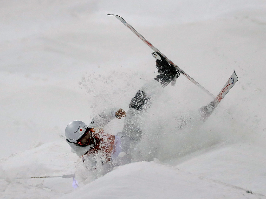 . Ikuma Horishima, of Japan, crashes during the men\'s moguls qualifying at Phoenix Snow Park at the 2018 Winter Olympics in Pyeongchang, South Korea, Monday, Feb. 12, 2018. (AP Photo/Lee Jin-man)
