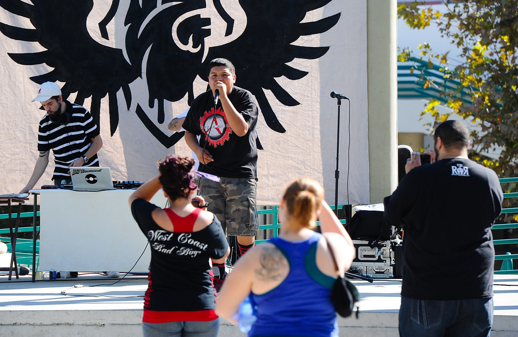 . San Bernardino rapper David Vara, 15, perfoms at the Turn Up the Vote event at Court Street Square in San Bernardino on Sunday, Oct. 20, 2013. Zealous Creative and San Bernardino Generation Now hosted the event in effort to encourage young adults to participate in the November 5 election. (Rachel Luna / San Bernardino Sun)