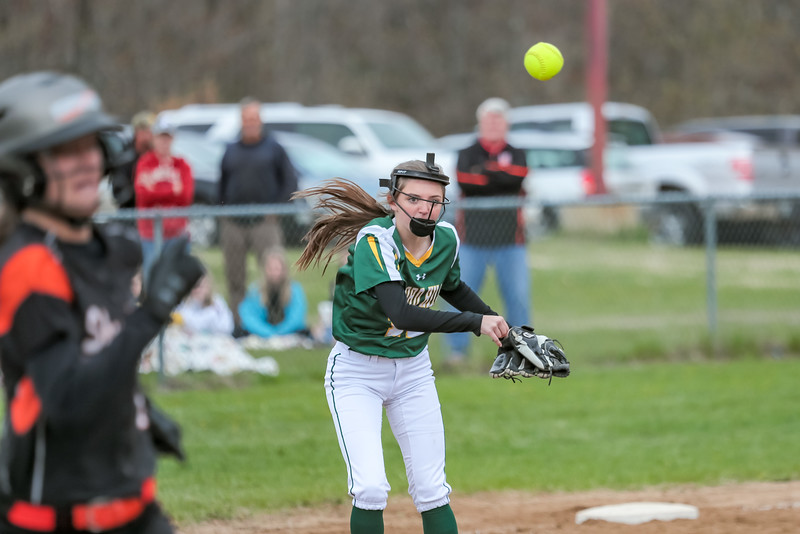 Oxford Hills third baseman Kaity Montelongo watches her throw sale to first base for the out.