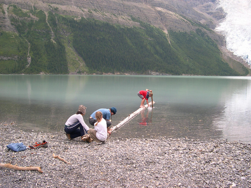 Three Engineers, One Lovely Assistant,  and One Iceberg: Shane, Tyler, Jayna, and Aunika employ a couple of logs to retrieve an iceberg from the fridgid lake.
