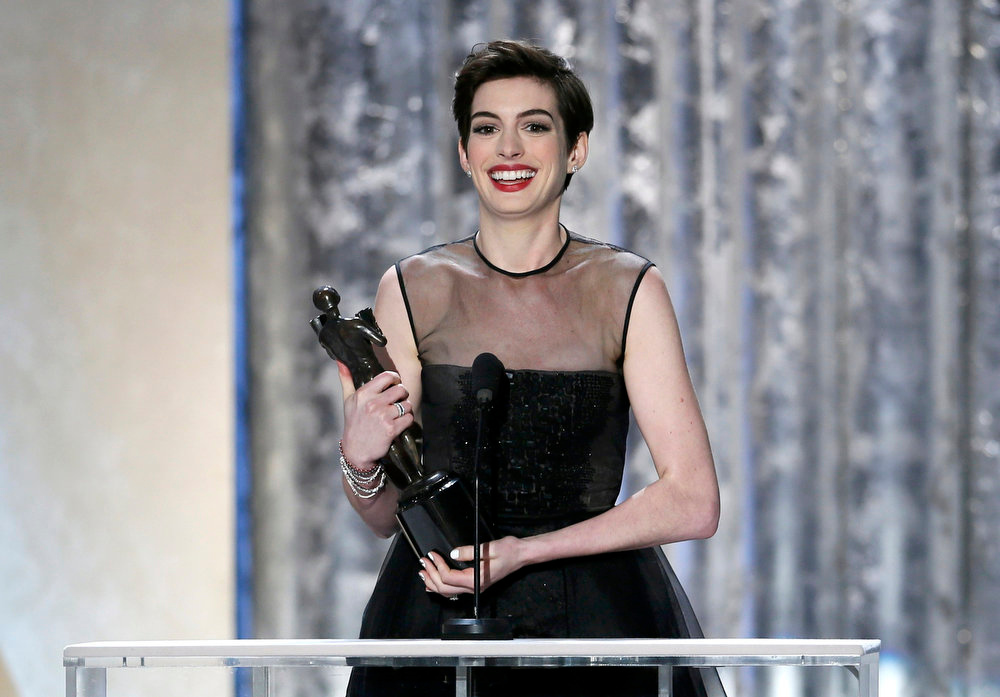". Actress Anne Hathaway, from the film ""Les Miserables,\"" accepts the award for outstanding female actor in a supporting role at the 19th annual Screen Actors Guild Awards in Los Angeles, California January 27, 2013.   REUTERS/Lucy Nicholson (UNITED STATES  - Tags: ENTERTAINMENT)   (SAGAWARDS-SHOW)"