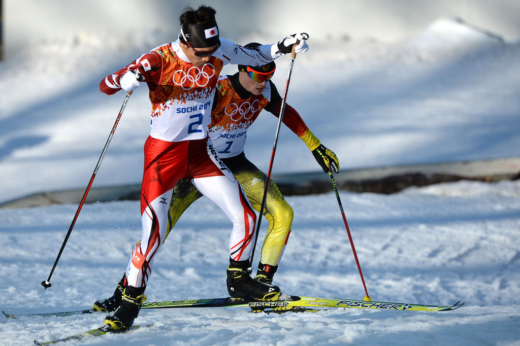 . Japan\'s Akito Watabe (2) and Germany\'s Eric Frenzel (1) ski to win silver and gold the Nordic Combined Individual NH / 10 km Cross-Country at the RusSki Gorki Jumping Center during the Sochi Winter Olympics on February 12, 2014, in Rosa Khutor near Sochi. AFP PHOTO / PETER PARKS/AFP/Getty Images