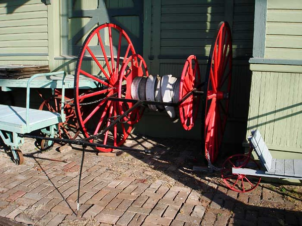 HOSE REEL M-K-T Museum, Galena Kansas  There are so many items outside the museum that may or may not have to deal with railroads (such as an Army tank!) that I hesitate to say that this hose reel belongs to the depot, but it certainly looks right at home.