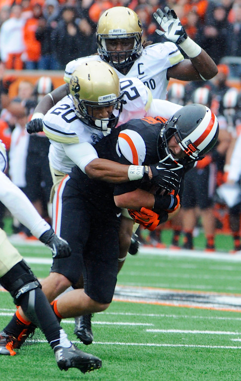 . Oregon State\'s Richard Mullaney is tackled by Colorado\'s Greg Henderson (20) after a catch in the first half of an NCAA college football game on Saturday, Sept 28, 2013, in Corvallis, Ore. (AP Photo/Greg Wahl-Stephens)