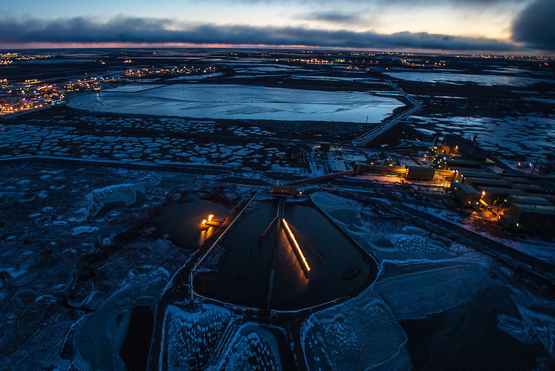 Oil Infrastructure from Alaska's Arctic Coastline, Prudhoe Bay Oil Fields. Drill pads and flares from oil drills in wetlands of the Arctic.