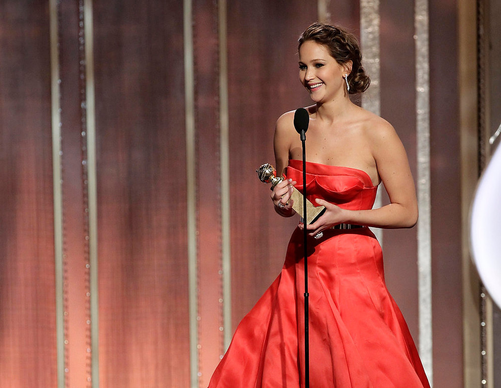 ". This image released by NBC shows actress Jennifer Lawrence with her award for best actress in in a motion picture comedy or musical for her role in ""Silver Linings Playbook\"" during the 70th Annual Golden Globe Awards at the Beverly Hilton Hotel on Jan. 13, 2013, in Beverly Hills, Calif. (AP Photo/NBC, Paul Drinkwater)"