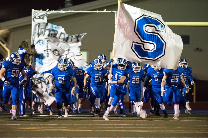 11/21/18  Wesley Bunnell | Staff  Southington vs Cheshire on Wednesday night at Southington High School. Kyle Messenger (43) carries the Southington flag onto the field.