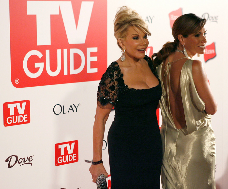 . TV personalities Joan Rivers, left, and Melissa Rivers pose for photographers at the 2006 TV Guide Emmy After Party in the Hollywood section of Los Angeles on Sunday, Aug. 27, 2006. (AP Photo/Matt Sayles)