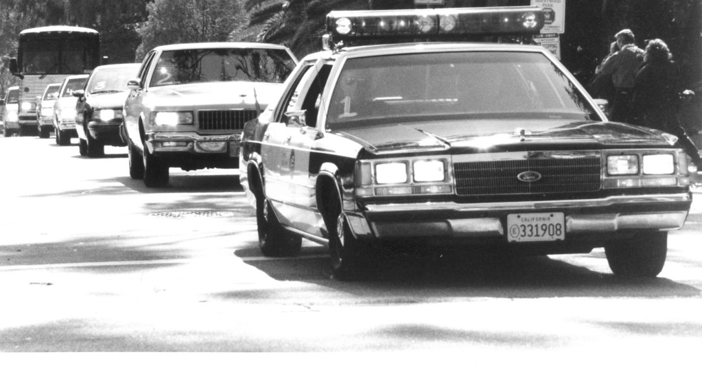 . LAPD as they escort the bus with the jury.  (2/12/95)   (Los Angeles Daily News file photo)