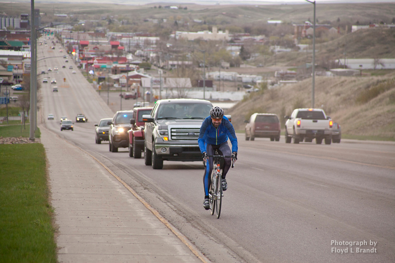 Havre Daily News/Floyd Brandt  Carrying the torch to Fort Benton from Havre, police officer Josh Holt climbs Havre Hill on a five hour trek for Special Olympics Tuesday.