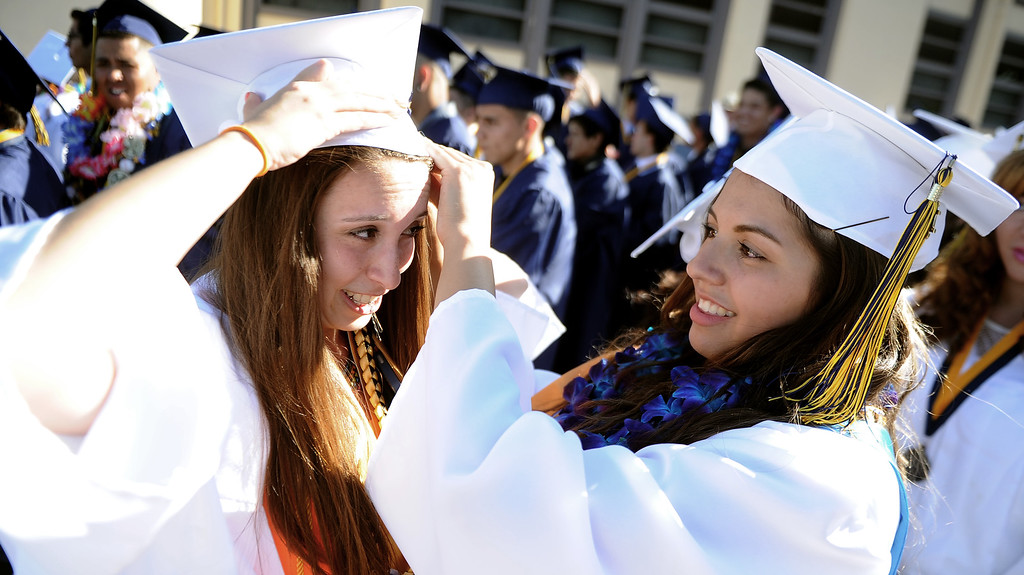 . Students Fernanda Sanchez, left, with Monica Espinoza prepare prior to the Montebello High School commencement at Montebello High School on Thursday, June 20, 2013 in Montebello, Calif.  (Keith Birmingham/Pasadena Star-News)