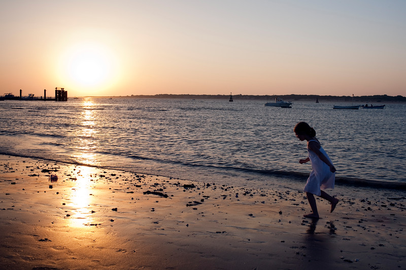 Little girl playing on Bajo de Guia beach by Guadalquivir river, town of Sanlucar de Barrameda, province of Cadiz, Andalusia, Spain.