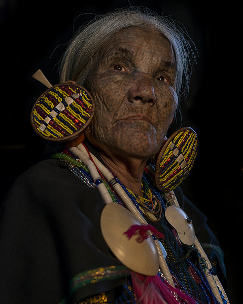 Older lady with face tattoos, traditional amongst the tribes of the Chin State.  Chin State Myanmar 2017