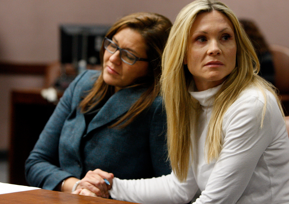 ". This Nov. 27, 2012 file photo shows attorney Ellen Torregrossa-O\'Connor, left, holding the hand of former ""Melrose Place\"" actress Amy Locane-Bovenizer, 40, of Hopewell Township, N.J. as the jury in her trial returns a verdict in Somerville, N.J.  Locane-Bovenizer, who was driving drunk when her SUV plowed into a car and killed a New Jersey woman, was sentenced Thursday, Feb. 14, 2013, to three years in prison.   (AP Photo/The Star-Ledger, Robert Sciarrino, filel)"