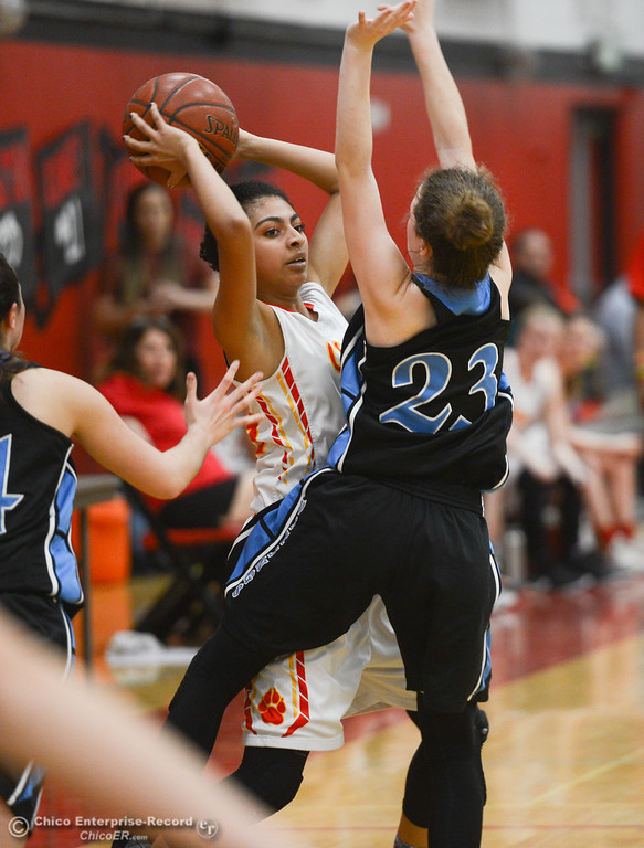 . Chico High\'s Adrianie Servin-Smith (23) is double-teamed by Pleasant Valley\'s Shaley Vieg (23) and Makenna Joyce (14), Thursday, February 8, 2018, in Chico, California. (Carin Dorghalli -- Enterprise-Record)